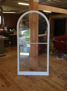 Arched top custom wood storm window sash