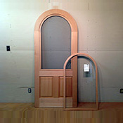 Custom wood arched top storm screen combination insert door