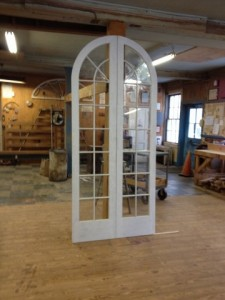 Custom wood arched top double storm doors