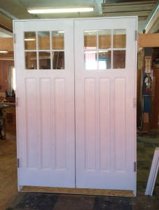 Custom wood double entryway door unit.