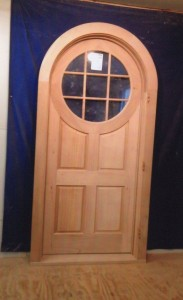 Custom wood arched top entry door unit