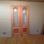 Custom wood arch top entryway door unit