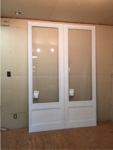Custom wood double storm doors