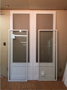 Custom wood storm screen combination insert doors.