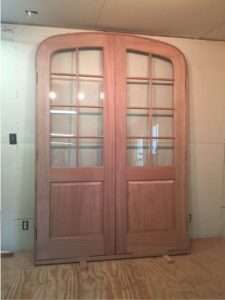 Arched top double mahogany wood entry door unit