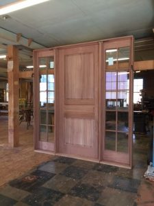 Custom wood mahogany door unit with side light units