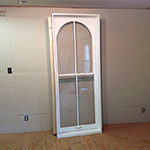 Arched top custom wood historical double hung window unit