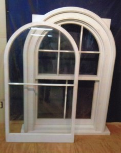 Historical reproduction arch top custom wood window unit.