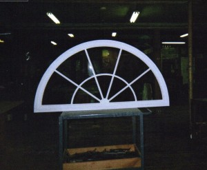 Custom wood arched top sun burst transom window sash