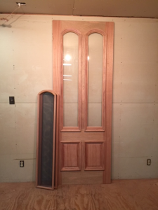Wood storm screen door